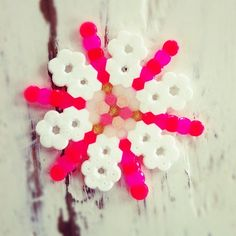 Sam is into making these little Christmas ornaments right now. Good for little fingers and patience! :)