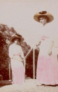 Grand Duchesses Tatiana and Olga Nikolaevna of Russia, ca. 1912. Hand-tinted by the girls.