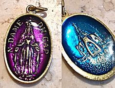 Vintage Purple Blue Enamel Notre Dame Medal Virgin Mary (Image1)Religious Catholic medal featuring Deep rich purple enamel front with Our Lady of Notre Dame, the Blessed Mother Virgin Mary and the back featuring the church in cobalt blue enamel. Gold tone.