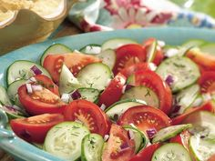 Dilled Cucumber & Tomato Salad     Ingredients:   2 medium cucumbers (thinly sliced in quarters)  1 package of grape tomatoes (cu...