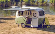 This Tiny Lightweight Camper Has Room For Everything You Need (And More) - CountryLiving.com Not vintage but this wee trailer has some great features!