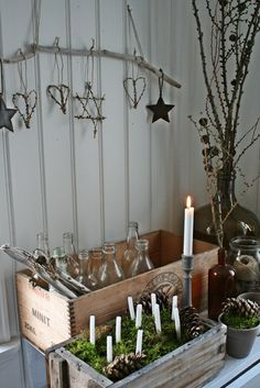 winter decorations--so simple, a branch hung from a string and decorations on it. Hearts and snowflakes, maybe.