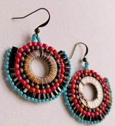 For the Desert Divas, beautiful brown shell rings are all snuggled up to matte seed beads in vermilion, bronze and sky blue for true Southwest elegance. I love the fan shape. I added some hex beads fo