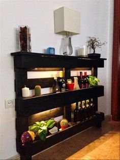 This is one of the wonderful and versatile pallet shelf projects in which you can keep many things like wine, lamp, and any decoration piece. This is ideal for any room of your house which gives a romantic look to your room. This is usually popular and truly great for home décor.
