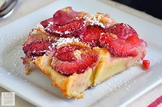 Strawberry Clafoutis | by Life Tastes Good is a twist on the scrumptious french dessert traditionally made with black cherries. This simple, yet impressive, dessert is brimming with sweet, fresh strawberries encased in a light and fluffy custard-like filling. The smooth, creamy texture just makes me close my eyes and savor every delectable bite! I bet you'll be surprised at how easy this is to make...