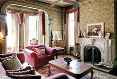 "The Bialk's 1872 Italianate parlor with ""Raspberry Bramble"" wallpaper and ""Acanthus"" border by Bradbury & Bradbury."