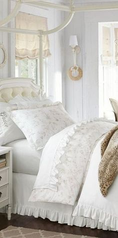 white canopy bed. loving the dust ruffle