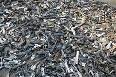 """""""Failure is the outcome of a certain perspective."""" Artist Pedro Reyes Melts 1,527 Guns And Turns Them Into Shovels For Planting Trees   (Image: Credit: Pedro Reyes)"""