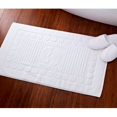 Add a little charm to your bathroom with this Cotton Bathmat. Heavy and robust with a weight of per square metre with feet design in white. Bath Mat, Happy, Fun, Design, Essentials, Bathroom, Simple, Towels, Cotton