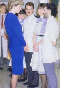 April 9, 1987: Princess Diana speaking with charge nurse, Shane Snape during the opening of the Broderip Ward Aids unit at the Middlesex Hospital.