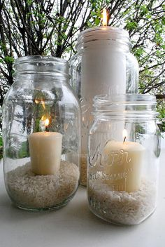 Cool idea - mason jar candle holders. Going to try this, to cluster candles on patio table around umbrella pole. And use Citronella candles for mosquito control.
