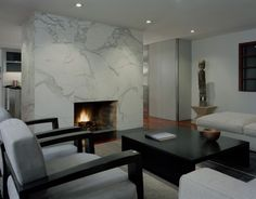 not crazy about the decor, but damn that marble wall/fireplace surround is pretty.