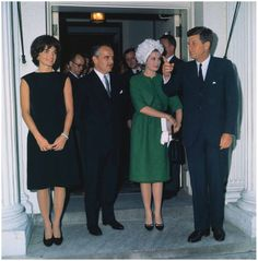 President & Mrs. Kennedy with Prince Rainier & Princess Grace at a 1961 White House reception.