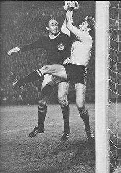 22nd October 1969. West German goalkeeper Sepp Maier catches under pressure from Scotland's Alan Gilzean during a World Cup Qualifier.