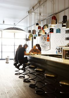cafe / Lamps made of used extinguisher by Castor Design.