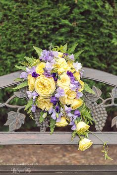 Doncaster wedding photography by Folega Photography . www.folegaphotography.co.uk Flowers by Paeony Floral Design in Doncaster. @paeonyfloral A Teardrop bouquet on a holder of lemon cathalina roses, lilac sweetpeas, lilac freesia , purple lizyanthus, mint and umberella fern and jasmin trails. #folegaphotographyfineartphotography #paeonyfloraldesign #weddingphotography