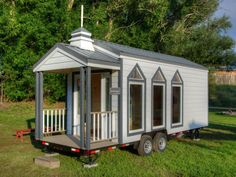 HGTV gives you a peek inside 13 small yet stylish tiny homes that you can take on the road with you.