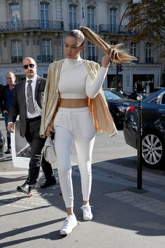 Gigi Hadid made sweats not just socially acceptable but chic. There is no distinction between gym and street style. She is now treating sweats as regular trousers and casual pants. Her most recent sweat outfit was all white deemed as chic. She says she can't stress the importance of a good coat and good shoes. Everyone is bringing sweats back especially on the streets. Kylie U.