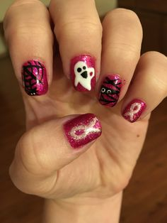Breast cancer awareness and Halloween nails.