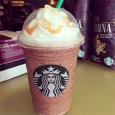 Ariana Grande Frappuccino = Cotton candy frappuccino + mocha chips + extra mocha syrup + extra whipped cream and extra caramel drizzle