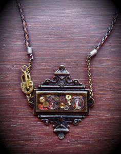 Kind of cool necklace made from Tim Holtz bookplates.