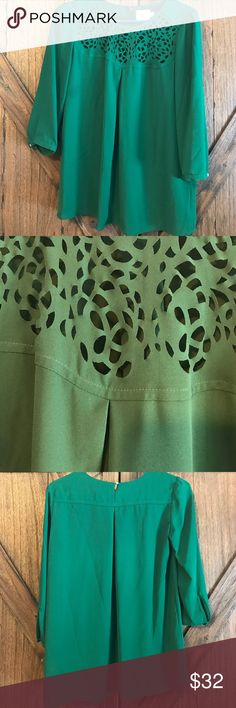 Anthropologie kelly green blouse Swingy, loose, flattering fit in a gorgeous emeralds green. Cutout detailing at the top and little gold button accents at sleeves and for closure at the back. Comes with an extra button. Machine washable and in perfect condition. Anthropologie Tops Blouses