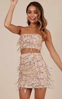 This two piece set is the ultimate party outfit this season! This mini length piece is the definition of chic and features sequin detailing. This two piece set will have you looking fab AF! - Made With 100% Polyester & Love-
