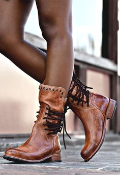 This handmade tan leather mid-calf boot by BEDSTU features side lacing and stud detaining.