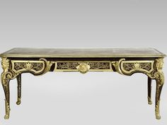 Flat desk, André-Charles Boulle, inlay of tortoiseshell, ebony, with gilded bronze female figures and feet in the shape of lion's paws (RMN, France)