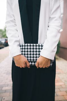 black and white tuxedo jacket and houndstooth clutch