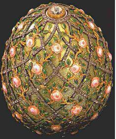 1907 Rose Trellis egg was a gift from Nicholas II to Alexandra Feodorovna. It is made of gold, enamel, diamonds and has a satin lining.  It is believed that the missing surprise was a chain made of diamonds and watercolor on ivory. It is currently in The Walters Art Gallery, Baltimore, Maryland.