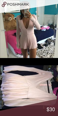 Pink romper Tried on once. Very warm fit low cut In cleavage but not too low. Very cute and trendy. Brand new. LF Dresses