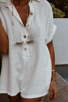 textured cotton short sleeve jumpsuit with collar and shell button up frontMade from cotton crossfireColour - crisp whiteWe recommend sizing up for added length