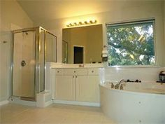 Walk-In Shower With Marble Slab Walls; Separate His/Her Vanities; Jetted Tub; Separate Commode Area; Hard Tile Flooring; New Paint