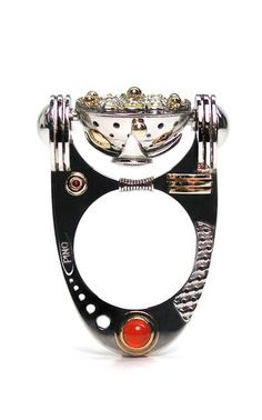Claudio Pino, Equilibrium, 2012, kinetic ring, 950 platinum/ruthenium platinum, 14-karat gold, yellow diamonds, ruby, carnelian, 48 x 30 x 30 mm with stand, photo: artist