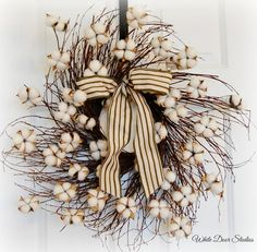 Gorgeous farmhouse style cotton boll wreath.  Imagine this on your front door.  Or go for the designer look and hang indoors in a rustic open frame.