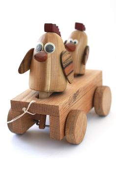 A wooden toy built from wood scraps and hardware.The birds move up and down while the toy is pulled.