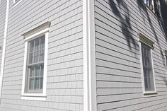 This James Hardie Siding Project was completed in Munsey Park, NY. We also included an extension and dormer on this home. The color choice of the HardieShingle on this home was Light Mist in a Straight Edge Panel layout.