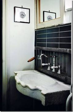 A stone sink, retro faucets, gres tiles. See more images on my blog...