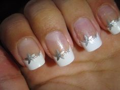 White French nails with a pretty flower perfect for the summer