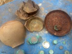 The treasure of the copper and silver coins in the pot covered with iron plate