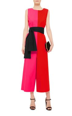 This bold and bright **Isa Arfen** jumpsuit features vivid color blocking and a relaxed, wide-legged silhouette cinched with a black waist tie.