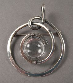 Brooch/Pendant | Henry Steig.  Sterling silver with quartz.  ca. 1955