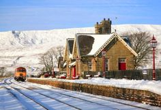 A Class 57 passes Ribblehead Station.The Settle to Carlisle railway.