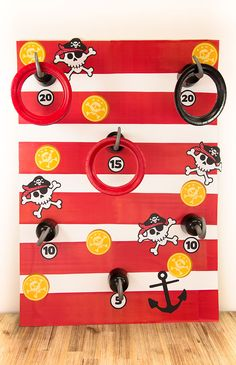 Great idea for a pirate party - this pirate hook toss game is really easy to make and all you need is a large piece of cardboard, some paper plates with the middle cut out and a few pirate hooks!