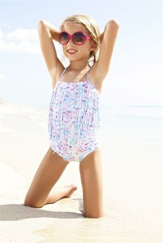 The Peixoto Kids Magnolia One Piece features a colorful tie dye print and designer fringe. The use of this fun print on a fringe top makes it an extra fun one piece for an extra fun girl. Your little girl will want to be rocking this one piece all year long! #peixoto
