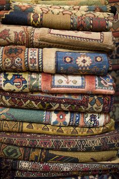 Carpets for sale a massive covered bazaar off of Imam Square in Esfahan, Iran
