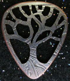 gorgeous metal carved guitar pick