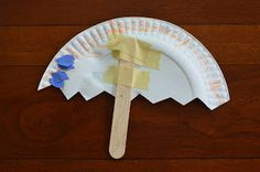 Making paper plate umbrellas on a rainy day