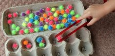Egg Carton counting with pom poms. Use yellow ones only for this book :)